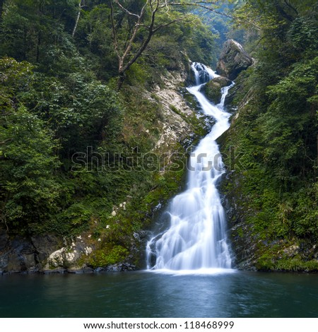 Mountain waterfall, like a piece of white cloth floating down. - stock photo