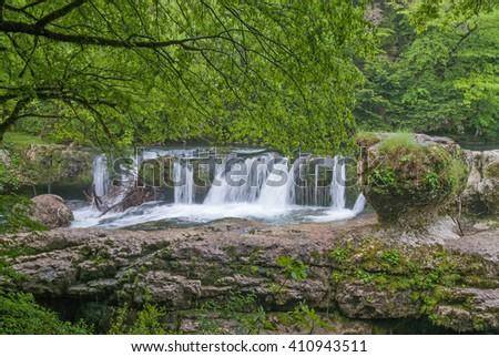 Mountain waterfall, the azure river. Georgia, Kutaisi - stock photo