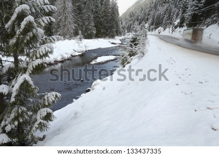 Mountain Winter Driving, British Columbia. A mountain Highway through Manning Park in the Cascade Mountains in winter. The Skagit River flows alongside. - stock photo