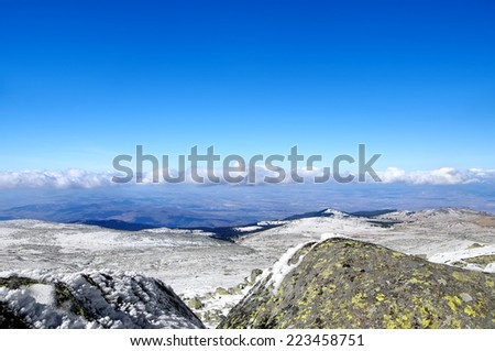 Mountain winter landscape with blue sky and snow - stock photo