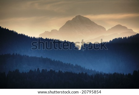 mountain with foggy valley - stock photo