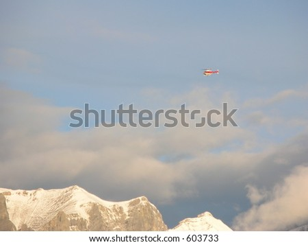 mountain with helicopter - stock photo