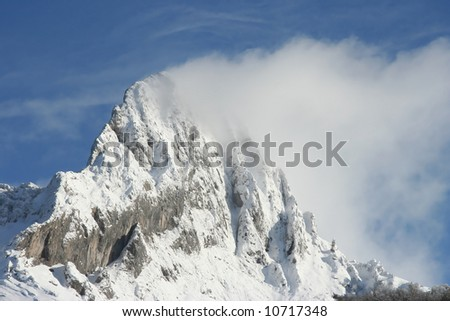 mountain with snow and cloud