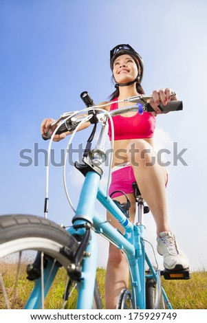 mountain woman biker and blue sky background - stock photo