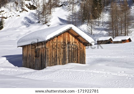 Mountain wooden cabin logs in the Dolomites, Passo Fedaia, Italy - stock photo