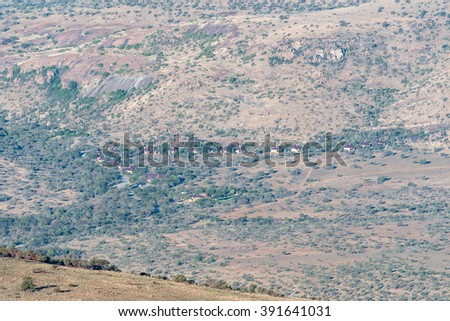 MOUNTAIN ZEBRA NATIONAL PARK, SOUTH AFRICA - FEBRUARY 16, 2016: A view of the offices, chalets and camping sites as seen from the mountain pass on the Kranskop Loop - stock photo