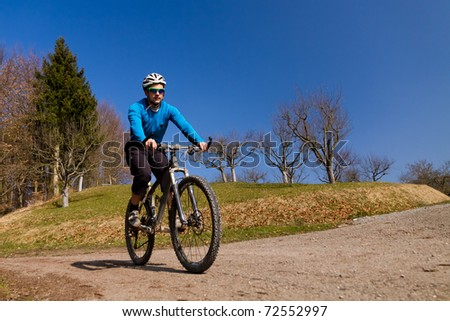 Mountainbiker on a cycling tour - stock photo