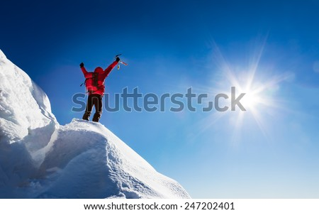 Mountaineer celebrates the conquest of the summit. Concepts: victory, success, achievement, triumph.   - stock photo