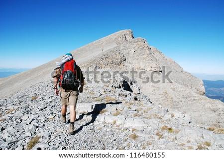 Mountaineer climb to the high mountain peak - stock photo