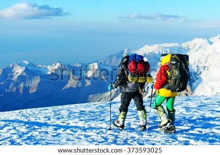 Mountaineer climb to the high mountain peak. Extreme sport - stock photo