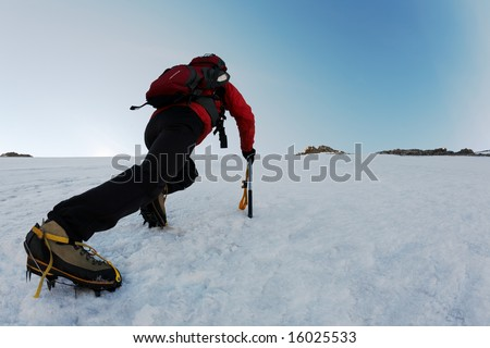 Mountaineer climbing a steep route on a icy slope, italian Alps, Europe. - stock photo