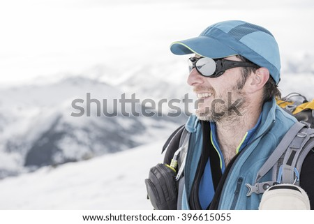 Mountaineer in a snowy mountain