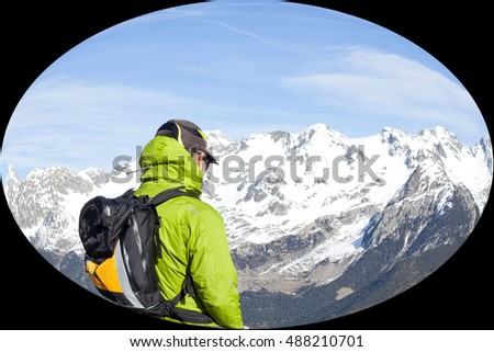 mountaineer looking at the scenery of the mountains