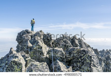 Mountaineer rope tied on a mountain ridge.
