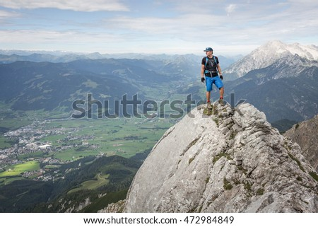 Mountaineer standing on a rock in the alps