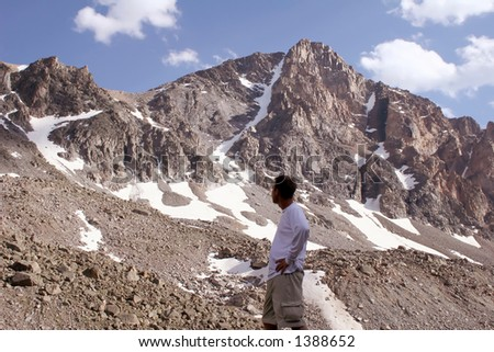 Mountaineer studying Whitetail Peak, Montana. - stock photo
