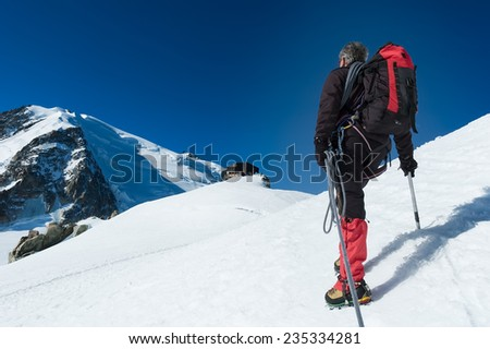 Mountaineer walking on the glacier during the climb of Mont Blanc. Chamonix, west Alps, France, Europe. - stock photo