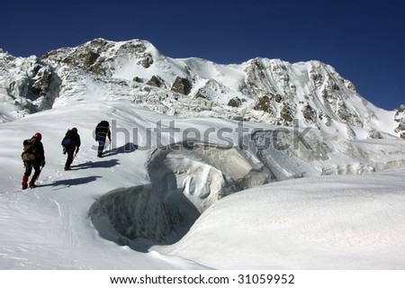 Mountaineers on the Glacier - stock photo