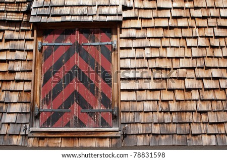 mountainhut in red and black with wood wall - stock photo