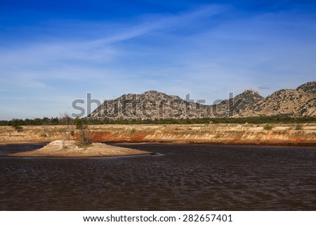 Mountainous Coastline at Ca Na, in the foreground, an artificial lake for salt extraction, Ninh Thuan, Vietnam