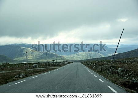 Mountainous landscape with a country road in Norway.