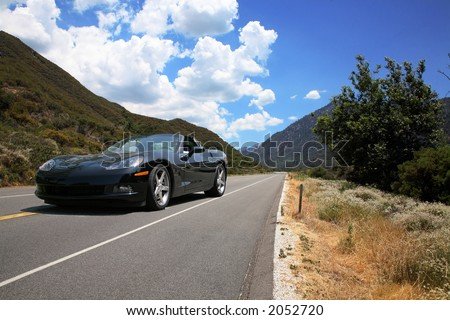 Mountainous Road with Beautiful Sky - stock photo