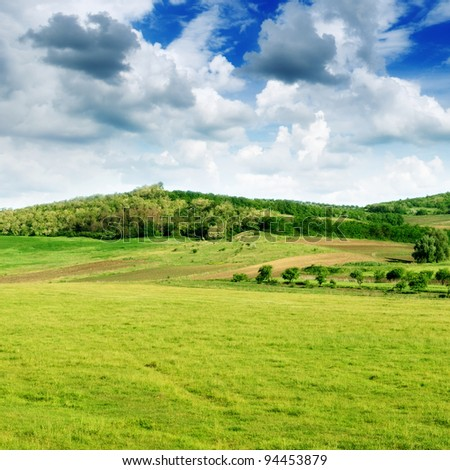 Mountainous terrain and the blue sky - stock photo