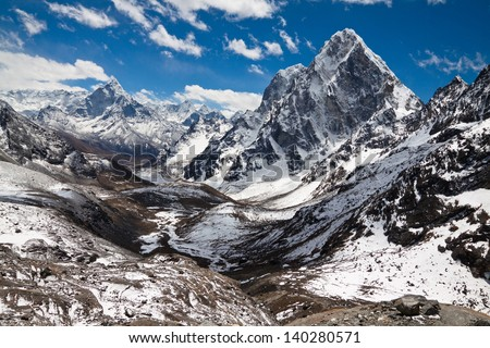 Mountains Ama Dablam, Cholatse, Tabuche Peak. Trek to Everest base camp. Himalayas. Nepal - stock photo
