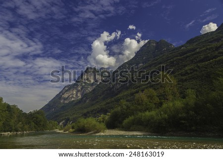 Mountains and a river landscape, in Switzerland. - stock photo