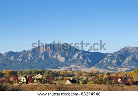 Mountains and farms on a bright autumn day near Boulder, Colorado - stock photo