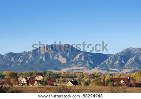 Mountains and farms on a bright autumn day near Boulder, Colorado - stock photo