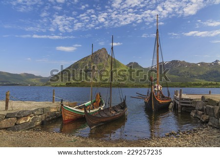 Mountains and fjord Sognefjord in Norway, Scandinavia. Old viking boat on seashore.  - stock photo
