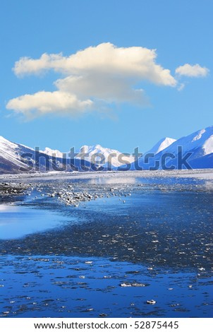 Mountains and frozen ocean in winter at Turnagain Arm Alaska - stock photo
