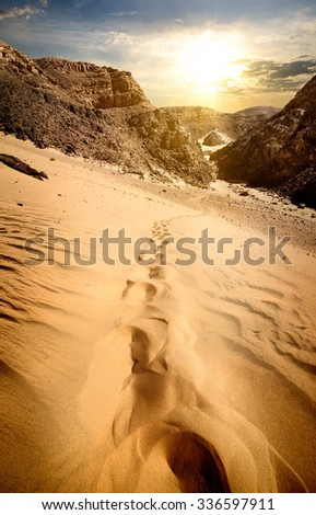 Mountains and sand dunes at the sunset - stock photo