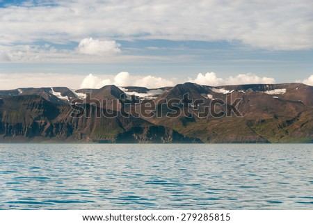 mountains and sea in Husavik in Iceland - stock photo