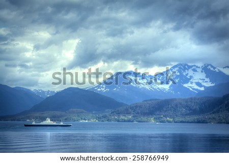 mountains and the sea connecting together form the most beautiful places where they live trolls. Norway and Iceland are wonderful places in Europe - stock photo