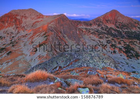 Mountains and valleys before dawn - stock photo