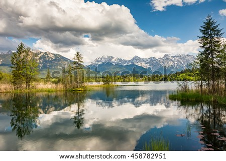 Mountains at lake Barmsee in the alps of Bavaria - stock photo