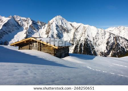 Mountains behind the ski hut - stock photo