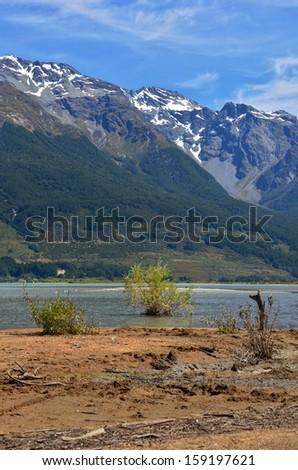 Mountains Beside Lake, Glenorchy, New Zealand - stock photo