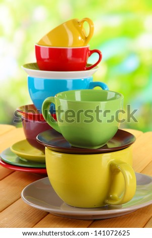 Mountains colorful dishes on nature background