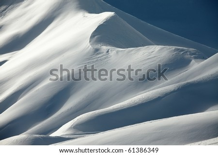 Mountains covered by snow - stock photo