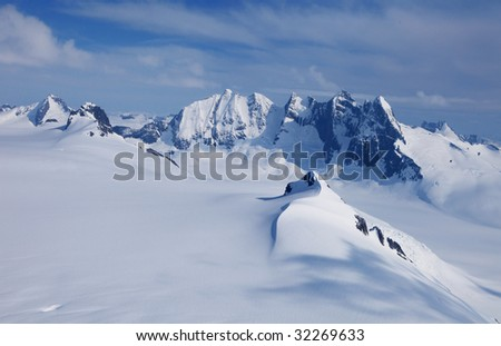 Mountains covered in snow - stock photo