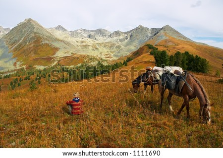 Mountains, girl and two horses, Altay - stock photo