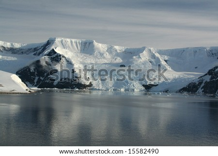 Mountains & glaciers reflected in calm ocean,		Neko Harbor, Andvord Bay,	Antarctica