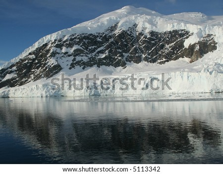 Mountains & glaciers reflected in glass like ocean,		Neko Harbor, Andvord Bay,	Antarctica