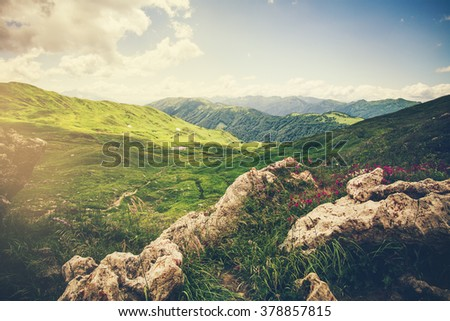 Mountains green valley and stones Landscape Summer Travel scenic view - stock photo