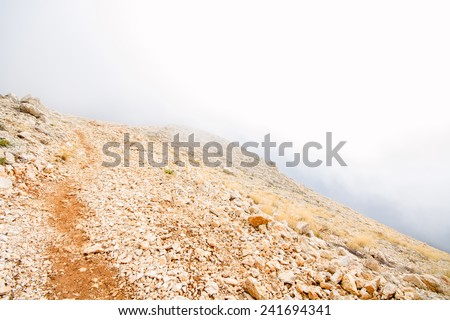 mountains hid behind a veil of mist - stock photo