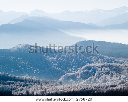 Mountains in a fog and hoarfrost
