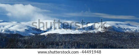 Mountains in a sun winter day. Russia, North Caucasus. Panorama
